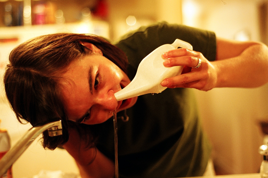 person using neti pot